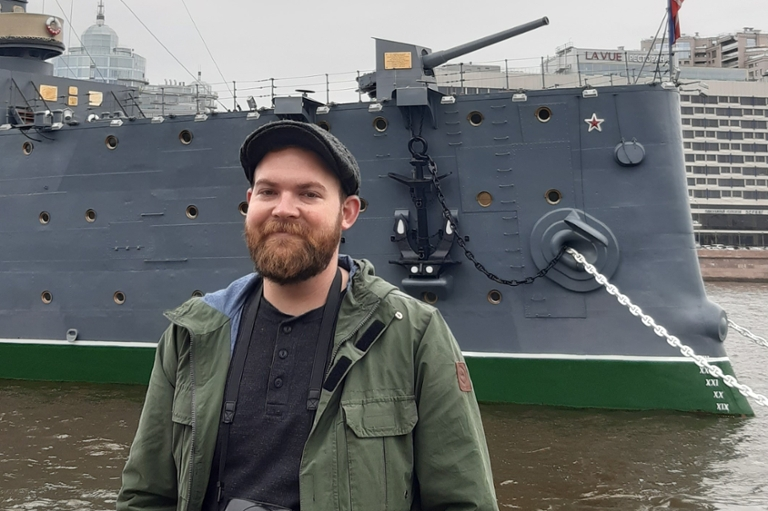 Nicholas Ingersoll poses in front of a ship during his FLAS award year in Russia.