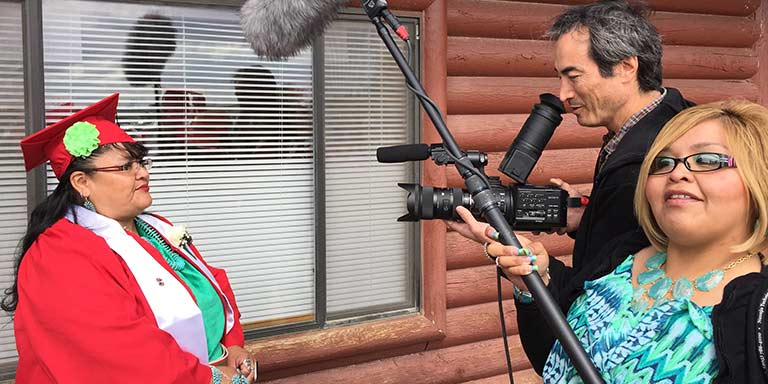 Smithsonian videographer Charles Weber and Navajo Tech staff Tammy interview a graduate in 2015